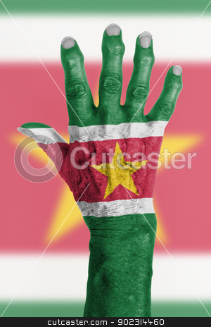 Hand of an old woman wrapped in flag stock photo, Hand of an old woman wrapped in flag of Suriname by michaklootwijk