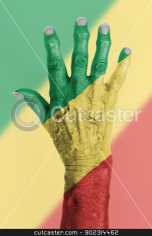 Hand of an old woman wrapped in flag stock photo, Hand of an old woman wrapped in flag of the republic of Congo by michaklootwijk