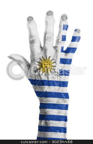 Hand of an old woman wrapped in flag stock photo, Hand of an old woman wrapped in flag of Uruguay by michaklootwijk