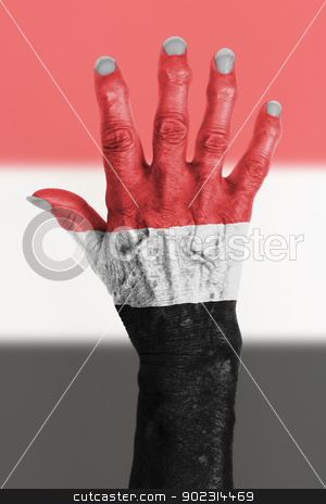 Hand of an old woman wrapped in flag stock photo, Hand of an old woman wrapped in flag of Yemen by michaklootwijk