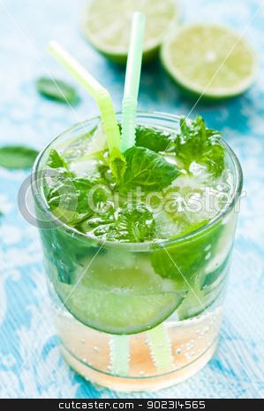 Mojito stock photo, Glass of mojito drink with ice, mint and lime by Tiramisu Studio