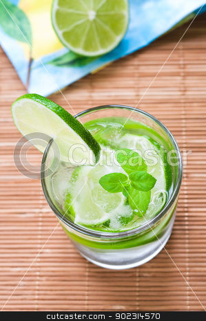 Mojito stock photo, Glass of mojito drink with ice, mint and lime by Tiramisu Studio