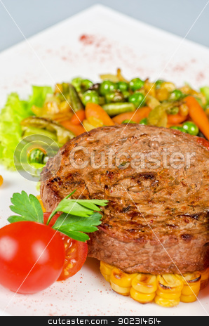 Beef steak meat stock photo, Beef steak meat with vegetables and sauce by olinchuk