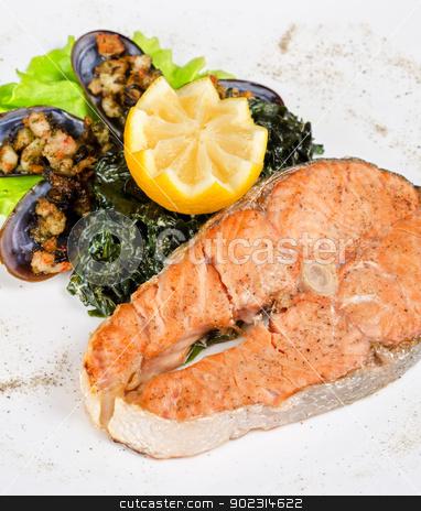 salmon steak stock photo, Tasty dish of salmon steak with algae mussels, lemon and kiwi by olinchuk