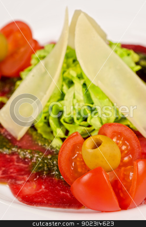 Meat carpaccio stock photo, Meat carpaccio from beef meat, parmesan cheese, olive, tomato, sauce pesto by olinchuk