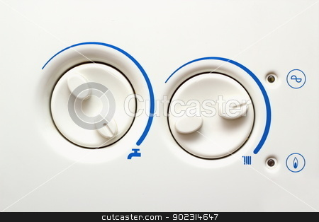 detail of hpusehold heating apliance stock photo, detail of buttons of an old household heating appliance by coroiu octavian