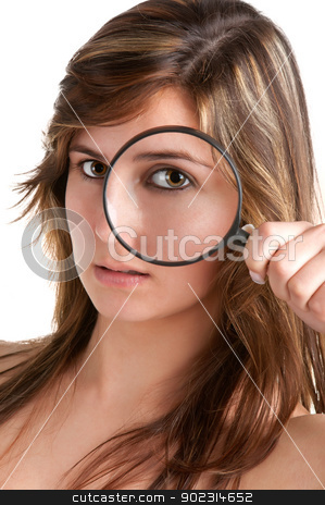 Woman looking trough a loupe stock photo, Woman looking trough a magnifying glass, isolated in a white background by ruigsantos