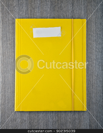 Yellow folder stock photo, A yellow folder with empty white paper label by Fabio Alcini