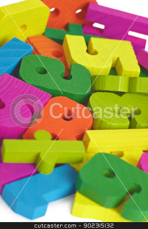Child toy wooden letters stock photo, Pile of child toy wooden color letters by Alexey Romanov