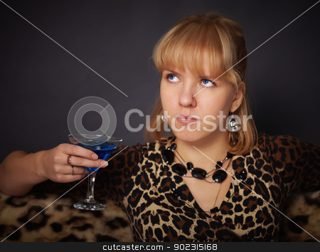 Beautiful young girl tries to exotic drink stock photo, A beautiful young girl tries to exotic drink on black background by Alexey Romanov