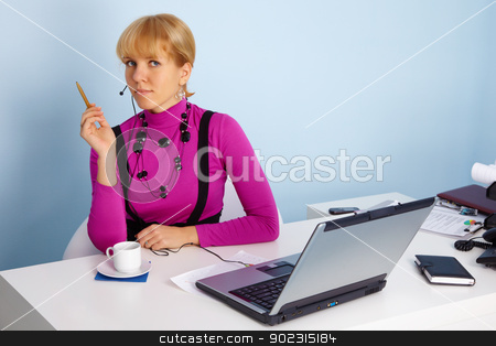 Woman - specialist of technical support stock photo, A young woman - a specialist of technical support by Alexey Romanov
