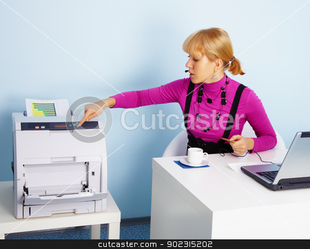 Young woman - secretary prints out a document stock photo, A young woman - the secretary prints out a color document by Alexey Romanov
