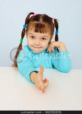 Funny little girl shows a finger stock photo, Funny little girl shows a finger on blue background by Alexey Romanov
