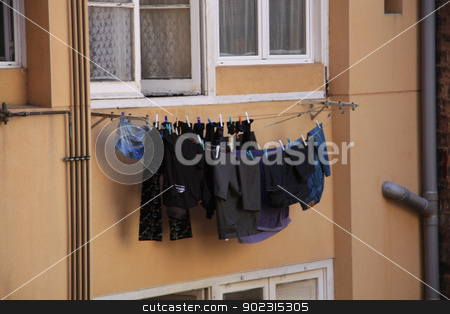 Laundry on a line stock photo, Fresh laundry on a line on wash day by Porto Sabbia