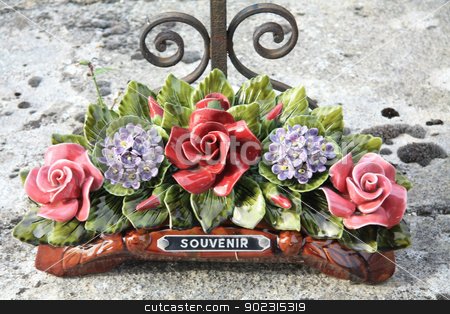 Ceramic sympathy flowers stock photo, Ceramic sympathy flowers at a French graveyard by Porto Sabbia