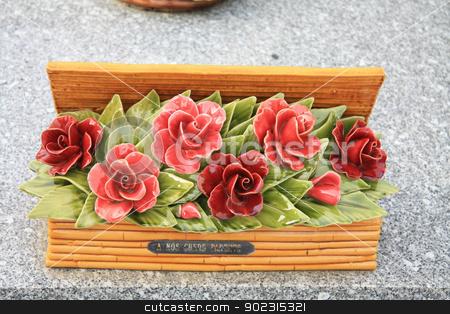 Ceramic sympathy flowers stock photo, Ceramic sympathy flowers at a French graveyard by Porto Sabbia