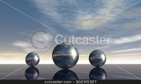 metalspheres stock photo, metal spheres under cloudy sky - 3d illustration by J?