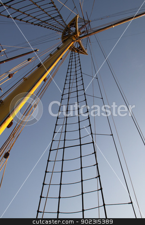 Mast stock photo, Yellow wooden mast of old sailing boat by vaximilian