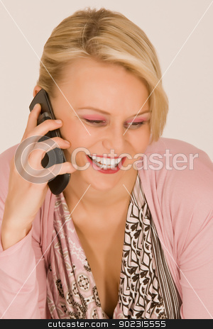Young woman with mobile phone stock photo, Fashionable young woman at the phone with a mobile phone by Roland Stollner