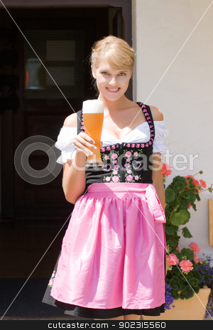 Young woman in dirndl with white beer stock photo, Young woman in dirndl wheat beer served in a mountain economy by Roland Stollner