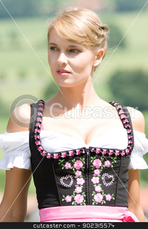Young woman in Bavarian costume stock photo, Portrait of a young Bavarian woman with cleavage by Roland Stollner