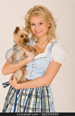 Woman and dog stock photo, Young Bavarian girl with a dog on his arm by Roland Stollner