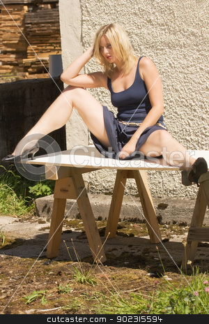 sexy young woman stock photo, Sexy young woman sitting on a table by Roland Stollner