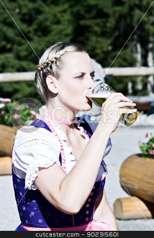 Bavarian woman in the beer garden stock photo, Bavarian woman in the beer garden with a glass of beer by Roland Stollner