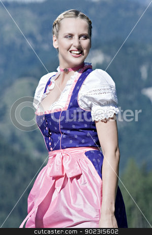 Summer in the mountains stock photo,  Beautiful girl on a Bavarian alpine meadow in the mountains by Roland Stollner