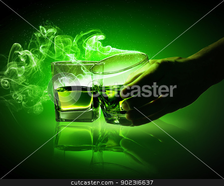 Two glasses of green absinthe stock photo, Hand holding one of two glasses of green absinthe with fume going out by Sergey Nivens