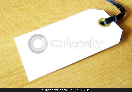 Blank tag  stock photo, Blank tag isolated on a wooden background by Vitaliy Pakhnyushchyy