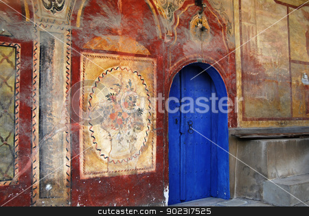 Old orthodox monastery  stock photo, Old orthodox monastery blue wooden back door by Aleksandar Varbenov