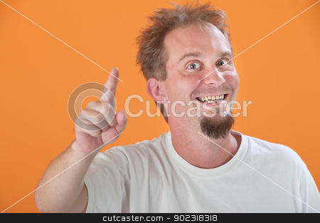 Man Points Up stock photo, Happy Caucasian man points index finger upward by Scott Griessel