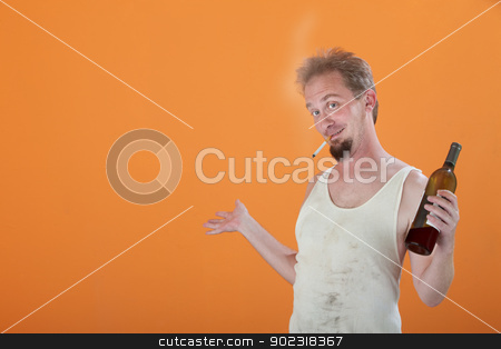 Smiling Man with Bottle and Cigarette stock photo, Happy Caucasian man with a bottle and lit cigarette by Scott Griessel