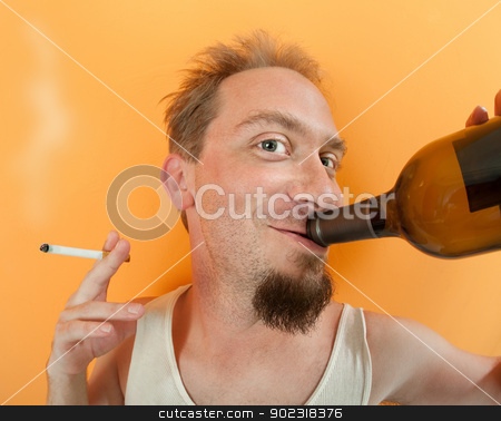 Happy Drunkard stock photo, Happy Caucasian man holding a bottle and a cigarette  by Scott Griessel