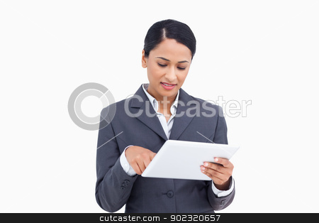 Close up of saleswoman with her touch screen computer stock photo, Close up of saleswoman with her touch screen computer against a white background by Wavebreak Media