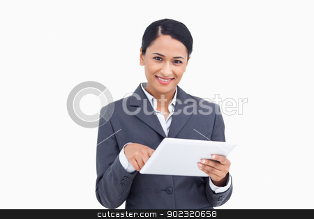 Close up of saleswoman with tablet computer stock photo, Close up of saleswoman with tablet computer against a white background by Wavebreak Media
