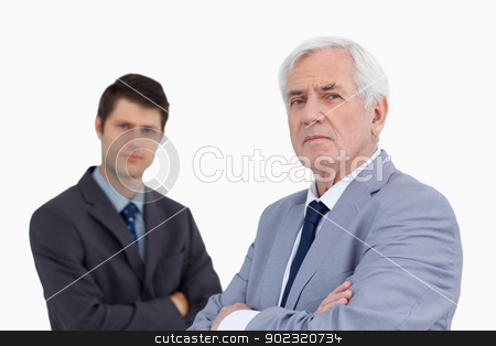 Close up of businessmen with arms folded stock photo, Close up of businessmen with arms folded against a white background by Wavebreak Media