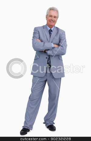 Smiling mature tradesman with his arms folded stock photo, Smiling mature tradesman with his arms folded against a white background by Wavebreak Media