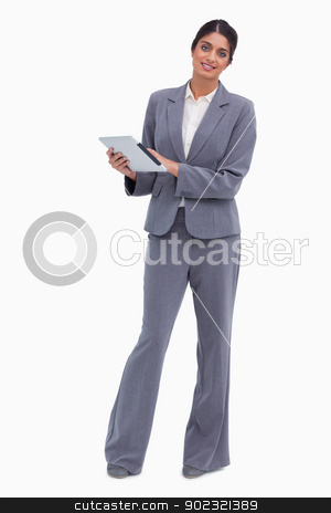 Smiling female entrepreneur with tablet computer stock photo, Smiling female entrepreneur with tablet computer against a white background by Wavebreak Media