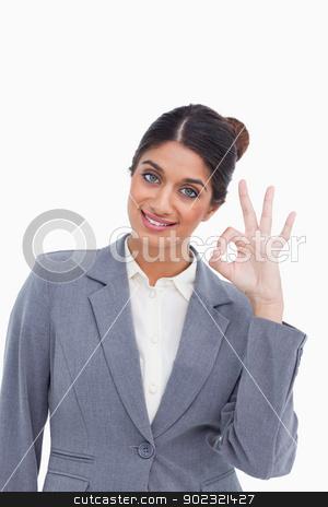 Female entrepreneur giving her approval stock photo, Female entrepreneur giving her approval against a white background by Wavebreak Media