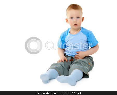 Surprised little boy sitting on white stock photo, Surprised a little boy sitting isolated on white background by Alexey Romanov