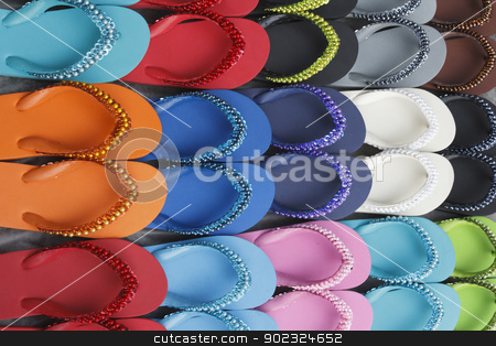 Flip flops set stock photo, Set of colourful flip flops display on Thailand street market by Suphatthra China