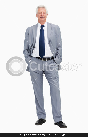 Portrait of a man in a suit with hands in the pockets stock photo, Portrait of a man in a suit with hands in the pockets against white babckground by Wavebreak Media