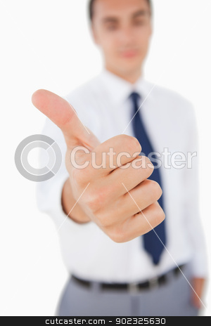 Close-up of a man the thumb-up stock photo, Close-up of a man the thumb-up against white background by Wavebreak Media