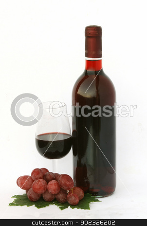 wine bottle and glass with grapes stock photo, a wine bottle and a glass with grapes by vaeenma