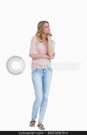 Thoughtful young woman looking away stock photo, Thoughtful young woman looking away against a white background by Wavebreak Media
