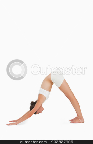 Woman doing yoga stock photo, Woman doing yoga against white background by Wavebreak Media