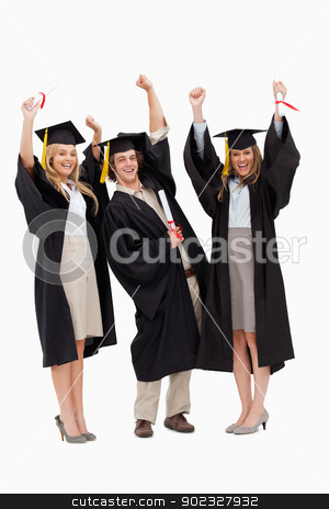 Three students in graduate robe raising their arms stock photo, Three students in graduate robe raising their arms against white background by Wavebreak Media