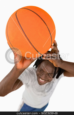 High angle view of smiling basketball player stock photo, High angle view of smiling basketball player against a white background by Wavebreak Media